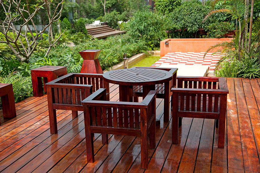 House patio with bamboo decking, wooden table and chairs